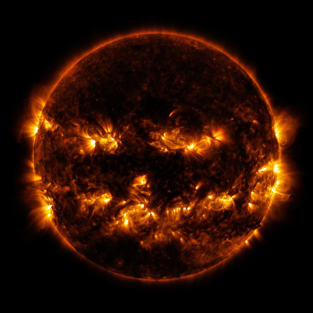 In this photo does the sun look like a jack-o-lantern to you?  This image showing the active regions of the sun was released by NASA on 10/8/14. Happy Halloween! (NASA)