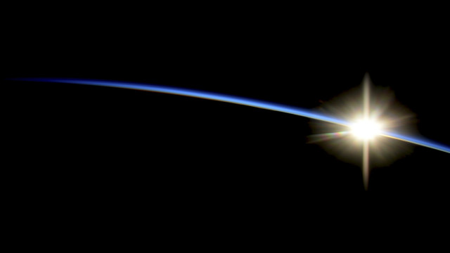 The sun peeks over the edge of Earth in a photo, taken on 10/29/14, by NASA astronaut Reid Wiseman from the International Space Station. (NASA)