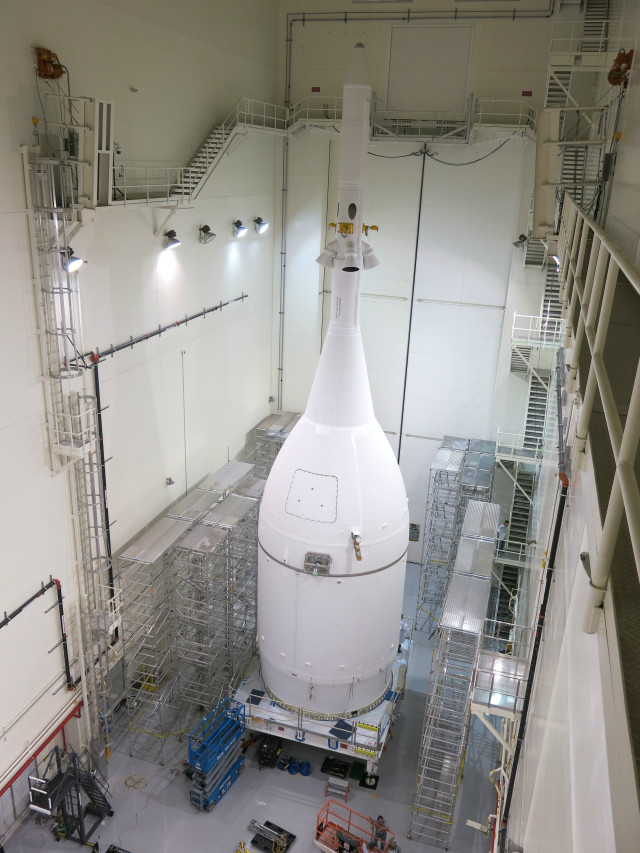 NASA's Orion spacecraft, shown here in the Kennedy Space Center's Launch Abort System Facility was finished 10/30/14.  It will be rolled out to Launch Complex 37 at Cape Canaveral Air Force Station on 11/10/14 and will be launched for a test flight on 12/4/14. (NASA/Lockheed Martin)