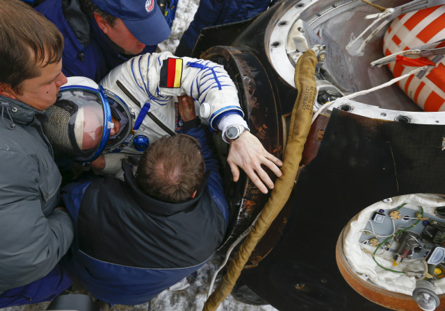 After spending 5 ½ months in orbit aboard the International Space Station, crew member Alexander Gerst of Germany is seen here being helped out a Soyuz TMA-13M space capsule after safely landing in a remote area in northern Kazakhstan November 10, 2014. Gerst returned to Earth with his fellow crewmembers Maxim Suraev of Russian and Reid Wiseman from the United States. (Reuters)