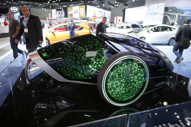 Visitors to the 2014 Los Angeles Auto Show are seen here, on November 20, 2014, examining the Toyota Future Mobility Concept car that was on display in Los Angeles, California. (Reuters)