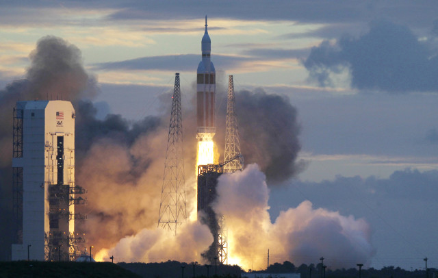 NASA sent its new Orion capsule, atop a Delta IV rocket, into space on its first unmanned orbital test flight on 12/5/14.  NASA hopes to use the new space capsule in the future for manned flights to an asteroid or perhaps even Mars. (AP/NASA)