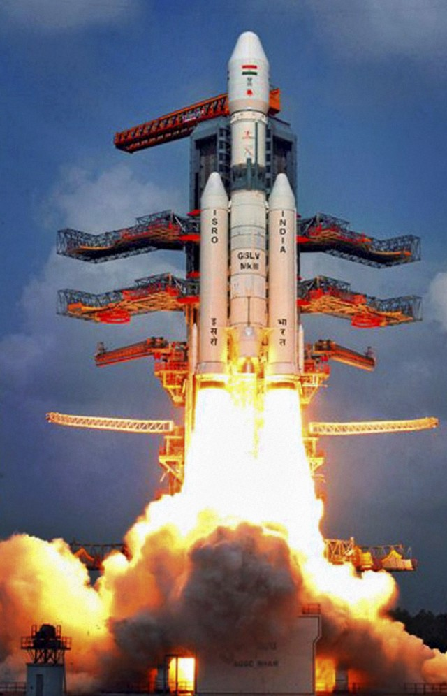 The Indian Space Research Organization (ISRO) successfully launched its heaviest rocket ever on 12/18/14.  Called the Geosynchronous Satellite Launch Vehicle (GSLV Mark-III), the huge rocket also carried an experimental crew module, CARE (Crew Module Atmospheric Re-entry Experiment), into space.  (AP/Press Trust of India)