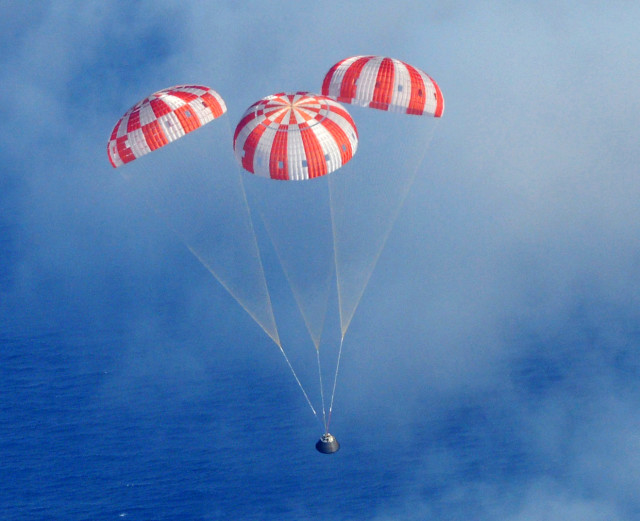 And of course what goes up must come down.  After successfully completing its first unmanned orbital test flight, NASA's Orion Crew Module is shown here as it descends to the Pacific Ocean under its three main parachutes on 12/5/14. (AP/US Navy)