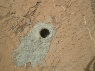"The first conclusive detection of Martian organic chemicals in material on the surface of Mars came from analysis by NASA's Curiosity Mars rover of sample powder from this mudstone target, ""Cumberland."" (NASA/JPL-Caltech/MSSS)"