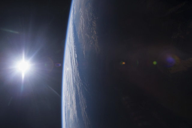 This amazing photo of the sun setting (left) over the Gulf of Mexico and the U.S. Gulf Coast (right) from space was posted to social media by the crew of the International Space Station on 12/14/14.  (Reuters/NASA)