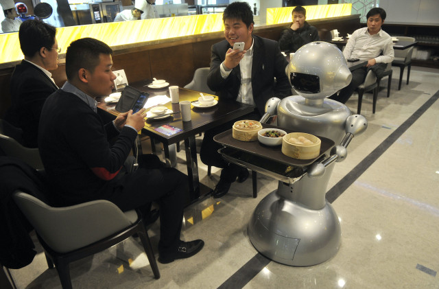 How much money are you supposed to tip your robot waiter?  A crew of 30 robots welcomes customers, cooks meals and delivers dishes at a restaurant located in Hefei, in the Chinese province of Anhui on 12/26/14. (Reuters)
