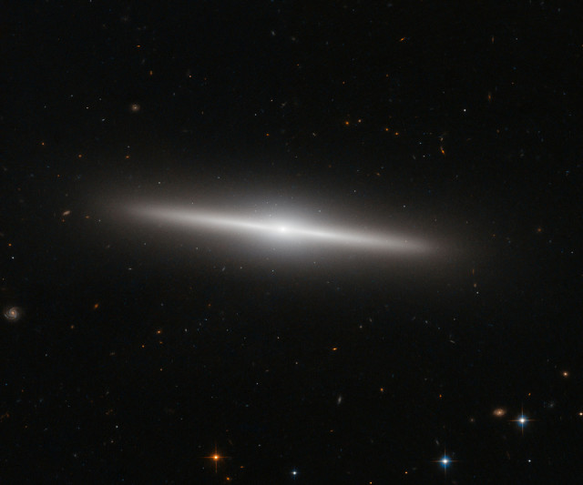 NASA and the European Space Agency released this new Hubble Space Telescope image of the galaxy IC 335 on 12/24/14.  The IC 335 galaxy is located in the Fornax Galaxy Cluster, which is about 60 million light-years away. (ESA/Hubble/NASA)