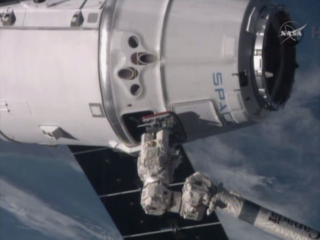 1/12/15, two days after being launched from Cape Canaveral, Florida, the SpaceX Dragon spacecraft was successfully captured by the International Space Station's Canadarm2 robotic arm.  The Dragon brought fresh supplies to the orbital outpost. (Reuters/NASA-TV)