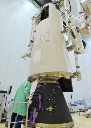 In this October 27, 2014 photo, a technician checks ESA's IXV Intermediate eXperimental Vehicle that's being prepared for launch on 2/11/15 ((c) ESA)