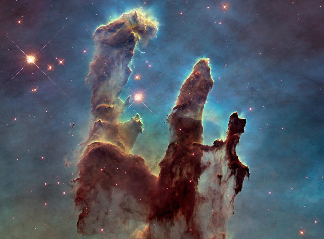"NASA released this Hubble Space Telescope image of the Eagle Nebula's ""Pillars of Creation"" on 1/6/15.  After comparing photos taken in 1996 and 2014, astronomers noticed that a narrow jet-like feature that may have been ejected from a newly forming star expanded its length over the nearly 19 year period. (Reuters/NASA/ESA/Hubble Heritage Team)"