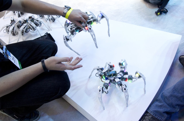 A 1/6/15 photo of some dancing spider-like robots that were displayed by Intel at this year's International Consumer Electronics Show in Las Vegas.  The robots were built by University of Arizona graduate student Matt Bunting.  (Reuters)