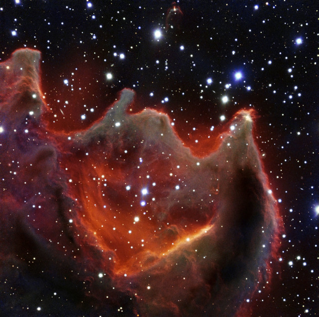 "The European Southern Observatory (ESO) recently released this photo of the cometary globule CG4, also called ""God's Hand"" that was imaged by its Very Large Telescope (VLT).  ESO says the exact nature of CG4 remains a mystery. (ESO)"