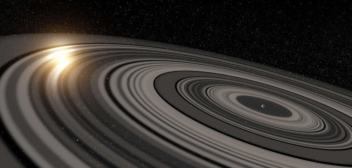 Artist's conception of the extrasolar ring system circling the young giant planet or brown dwarf J1407b. (Ron Miller)