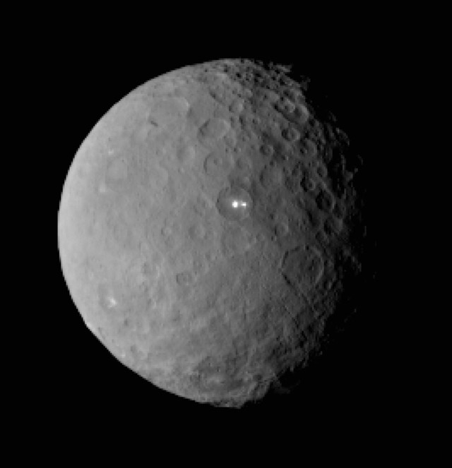 This is an image of the dwarf planet Ceres taken by NASA's Dawn spacecraft on 2/19/15 from a distance of nearly 46,000 kilometers.  It shows that the mysterious bright spot, noticed earlier by scientists, shares its basin location with a dimmer companion.  Dawn is preparing to rendezvous with Ceres and go into orbit 3/7/15 after a three-year journey. (NASA/JPL-Caltech/UCLA/MPS/DLR/IDA)
