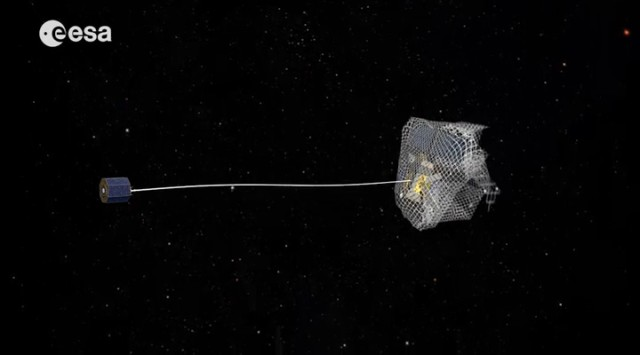 One capture concept being explored through ESA's e.Deorbit system study for Active Debris Removal - capturing the satellite in a net attached to either a flexible tether - as seen here - or a rigid connection. ((c) ESA)
