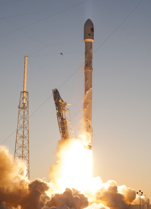 NOAA's Deep Space Climate Observatory Satellite which was carried aboard the SpaceX Falcon 9 rocket is shown here lifting off from launch pad 40 at the Cape Canaveral Air Force Station in Cape Canaveral, Florida 2/11/2015.  The new NOAA satellite will help keep tabs on solar storms and image Earth from nearly 1.6 million km away.  (Reuters)