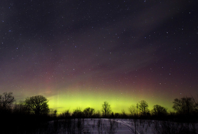 The glow of the Aurora Borealis, or Northern Lights, is seen in the horizon in the Kawartha Lakes region of southern Ontario 2/23/15.  The colorful Aurora Borealis, caused by charged particles from the sun, is rarely seen in Ontario.  (Reuters)