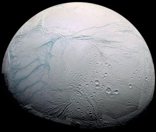 Saturn's icy moon Enceladus is spewing tiny silica grains, an indication hydrothermal activity is occurring in its ice-covered ocean. Such extreme environments are known to be suitable for life on Earth. (NASA/JPL)