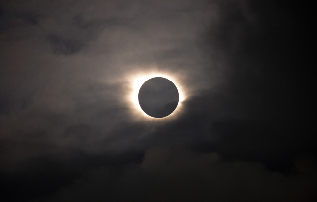 A total solar eclipse is visible through the clouds as seen from Vagar on the Faeroe Islands on 3/30/15.  The Faeroe Islands is an archipelago located halfway between Norway and Iceland. (AP)