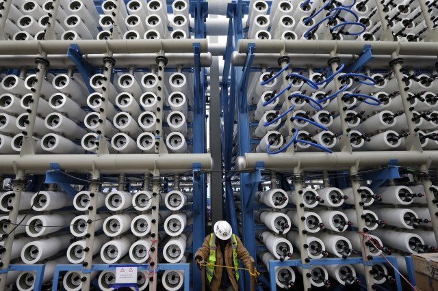 This 3/11/15 file photo shows an array of some of the 2,000 pressure vessels used to convert seawater into fresh water in the Carlsbad Desalination Project's plant, Carlsbad, Calif.  Considered to be the largest desalination facility in the western hemisphere, it is scheduled to start operations some time later this year and is expected to provide 50 million gallons of fresh drinking water a day.  (AP)