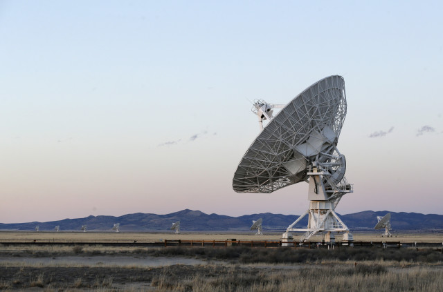Sunset falls over antennae at the National Radio Astronomy Observatory's Very Large Array, on 3/3/15.  The radio astronomy antenna array is located in Socorro County, New Mexico. (AP)