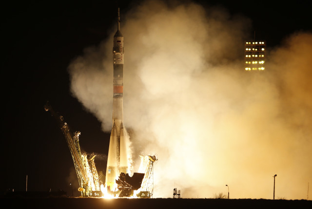 A Soyuz spacecraft carrying a new crew to the International Space Station, blasts off from Baikonur cosmodrome, Kazakhstan on 3/28/15.  The Russian rocket carries U.S. astronaut Scott Kelly, Russian cosmonauts Gennady Padalka, and Mikhail Korniyenko. (AP)