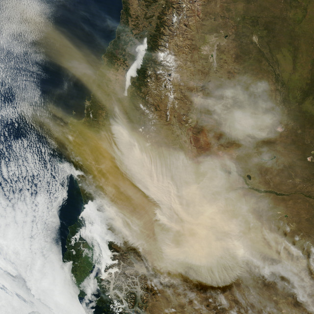 This photo taken from outer space by NASA's Earth observing Terra satellite on 4/23/15 shows an ash plume rising from the erupting Calbuco volcano in southern Chile. (NASA's Earth Observatory)