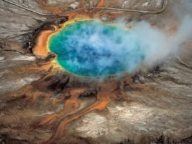 The gorgeous colors of Yellowstone National Park's Grand Prismatic hot spring are among the park's many hydrothermal features created by the fact that Yellowstone sits above a supervolcano – the largest type of volcano on Earth. (Robert B. Smith & Lee J. Siegel)