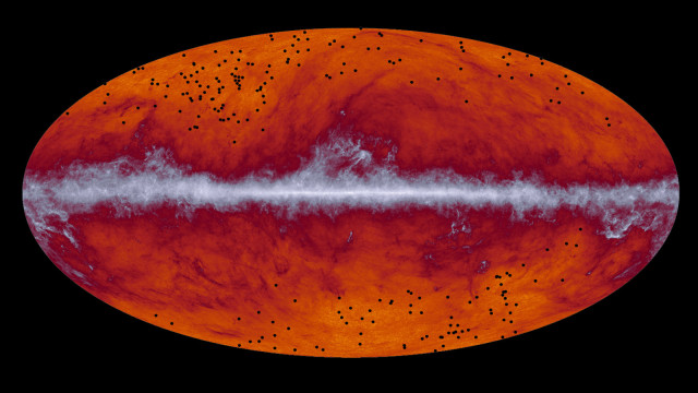"Researchers in a study released on 3/13/15 have successfully identified what they are calling a ""treasure chest"" of ancient galaxy clusters. This map of the entire sky was captured by the European Space Agency's Planck mission. The band running through the middle corresponds to dust in our Milky Way galaxy. The black dots indicate the location of galaxy cluster candidates identified by Planck and subsequently observed by the European Space Agency's Herschel mission.  (ESA/Planck Collaboration/ H. Dole, D. Guéry & G. Hurier, IAS/University Paris-Sud/CNRS/CNES)"