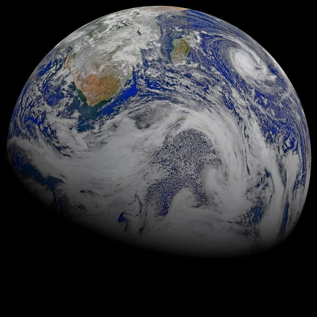 NASA/NOAA Suomi National Polar-orbiting Partnership spacecraft captured this combination image of Southern Africa and the surrounding oceans on 4/9/15 and released it to the public on 4/21/15 just in time for Earth Day the following day.  Note: Tropical Cyclone Joalane can be seen (upper right side) over the Indian Ocean.  (Ocean Biology Processing Group/Goddard Space Flight Center)
