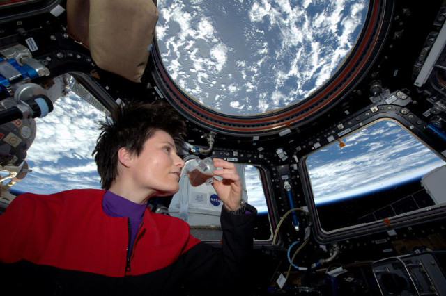 NASA posted this photo on 5/3/15, of Italian astronaut Samantha Cristoforetti sipping a cup of espresso aboard the International Space Station.  Her cup of the robust coffee was brewed with the first ever espresso machine in space. (NASA)