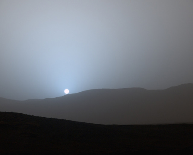 Sunset on Mars – On 5/8/15, NASA's Jet Propulsion Laboratory released this color image captured a few weeks earlier by the Curiosity rover from its location in Gale Crater. (NASA/JPL-Caltech/MSSS/Texas A&M Univ.)