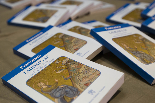 "Copies of Pope Francis' encyclical ""Laudato Si,"" (Praise Be) are displayed prior to the start of a press conference, at the Vatican, Thursday, June 18, 2015. (AP)"