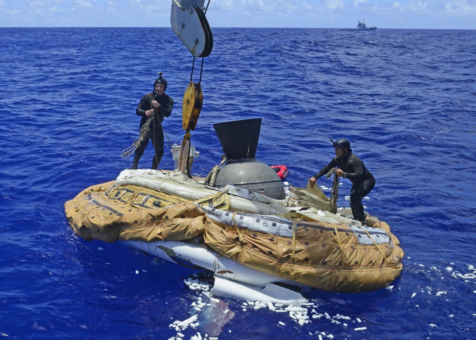 U.S. Navy sailors recover the test vehicle for NASA's Low-Density Supersonic Decelerator (LDSD) off the coast of Kauai, Hawaii on June 8, 2015.  NASA officials said that the parachute inflated during the test of new technology for landing larger spacecraft on Mars, but it then disintegrated immediately afterward (U.S. Navy)