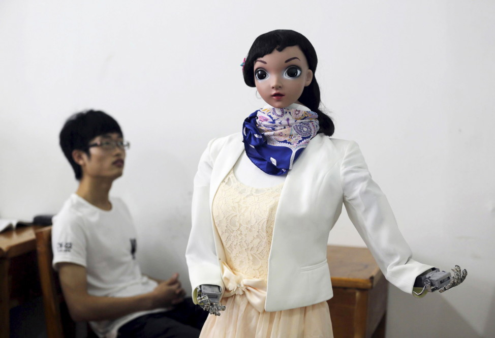 "Meet Xiomei.   Seen during a demonstration, on June 3, 2015, at a class of China's Jiujiang University, the robot teacher is able to narrate teaching materials and can respond to several voice orders like ""repeat"" or ""continue"". (Reuters)"