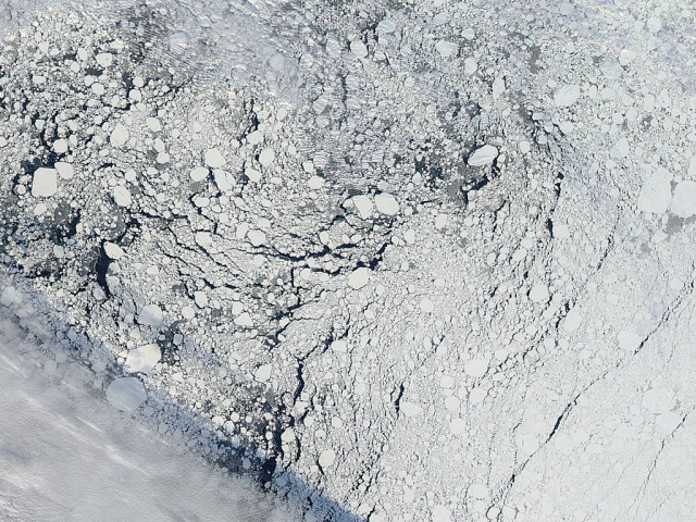 An image of an area of the Arctic sea ice pack well north of Alaska, captured by the MODIS instrument on NASA's Aqua satellite on Sept. 13, 2013 (NASA)