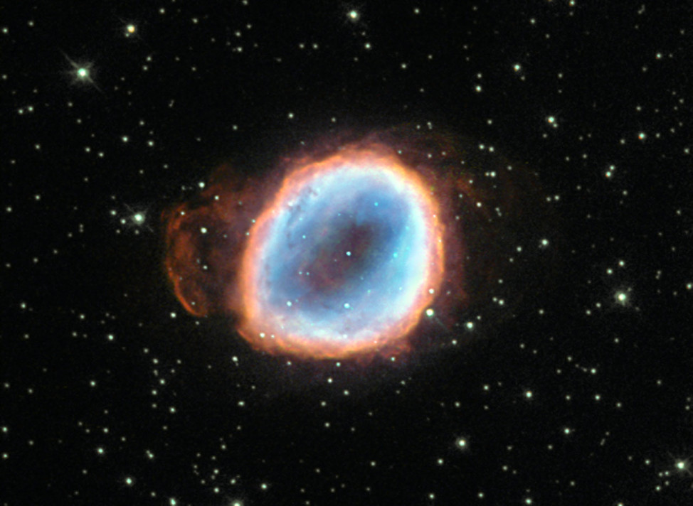 A dying star's final moments are captured in this image from the NASA/ESA Hubble Space Telescope released on 7/27/15.  As the star was dying it burst into a planetary nebula known as NGC 6565. (ESA/Hubble & NASA)