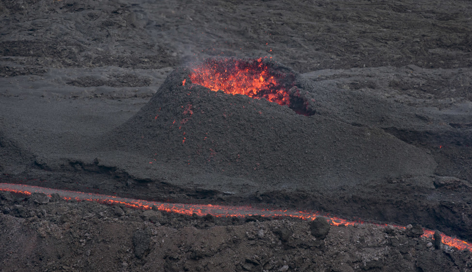 "Lava erupts from the Piton de la Fournaise ""Peak of the Furnace"" volcano, on the southeastern corner of the Indian Ocean island of Reunion Saturday on 8/1/15.  Piton de la Fournaise is one of the most active volcanoes in the world is currently erupting on this Indian Ocean island. (AP)"