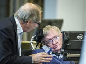 Nobel physics laureate Gerard 't Hooft, of Utrecht University, the Netherlands, confers with Stephen Hawking after the Cambridge professor presented his solution to the information loss paradox. Hawking is in town for a weeklong conference on the information loss paradox, which is co-hosted by Nordita at KTH Royal Institute of Technology. (Håkan Lindgren/KTH Royal Institute of Technology)