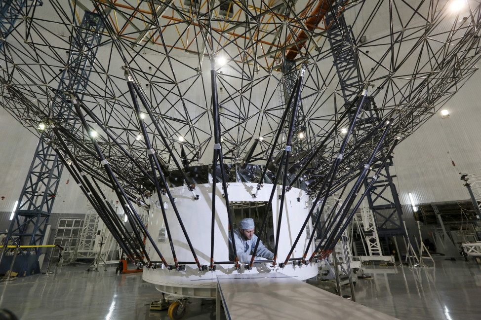 A technician is seen here on 8/21/15 working on a central mirror of the Millimetron space observatory at Reshetnev Information Satellite Systems.  The company is located in the Siberian town of Zheleznogorsk, outside Krasnoyarsk, Russia (Reuters)