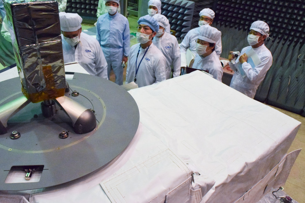 Technicians check out the CALorimetric Electron Telescope (CALET) and Flight Crew Interface Test (FCIT).  CALET, which was sent to the International Space Station on 8/24/15 aboard a Japan Aerospace eXploration Agency (JAXA's) resupply spacecraft.  The CALET will search for signatures of dark matter and provide the highest energy direct measurements of the cosmic ray electron spectrum. (NASA)