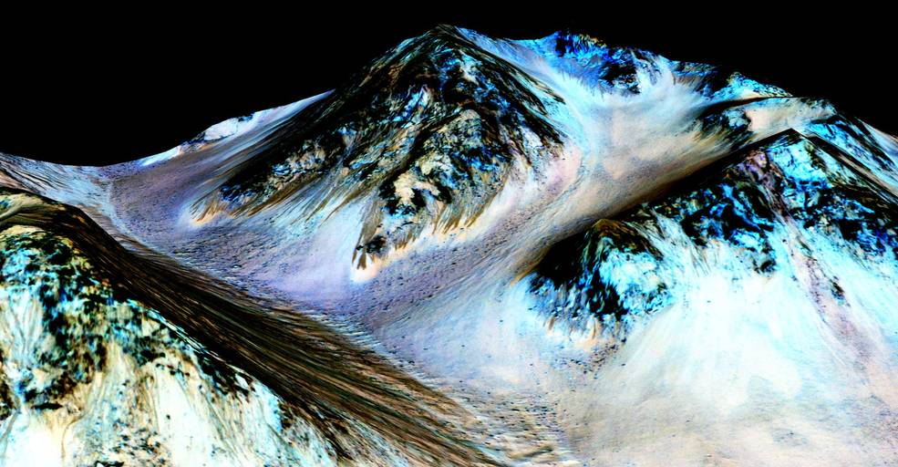 These dark, narrow, 100 meter-long streaks called recurring slope lineae flowing downhill on Mars are inferred to have been formed by contemporary flowing water. Recently, planetary scientists detected hydrated salts on these slopes at Hale crater, corroborating their original hypothesis that the streaks are indeed formed by liquid water. (NASA/JPL/University of Arizona)