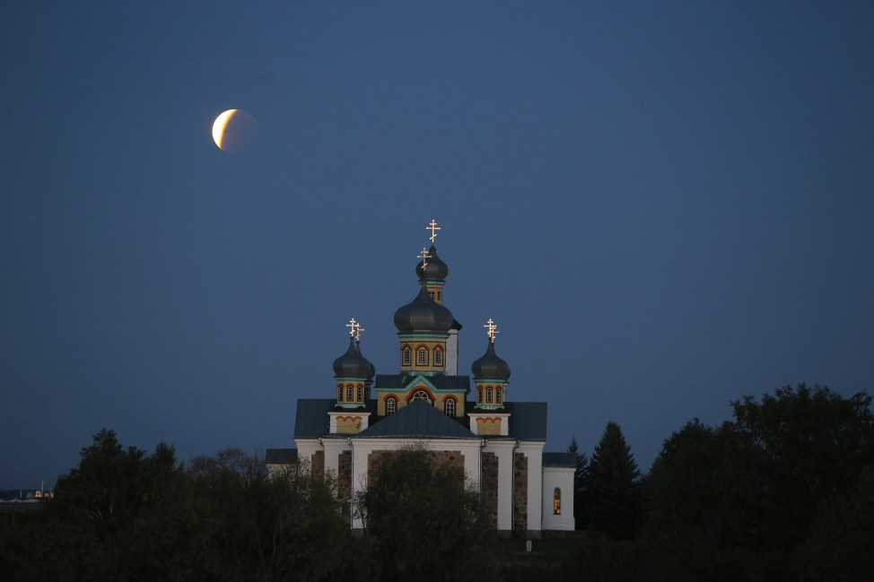 A perigee full moon or supermoon is when a full moon makes its closest approach to Earth during its elliptical orbit.  Skywatchers were treated to a rare combination of a supermoon and a total lunar eclipse on 9/27/15.  Here's a look at the supermoon behind an Orthodox church in Belarus as it nears the end of the eclipse.  (AP)