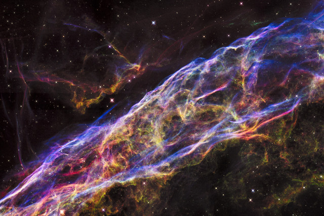 Mosaic image captured by the NASA/ESA Hubble Space Telescope shows a detailed look of the a small section of the Veil Nebula, the remains of a massive star that exploded about 8,000 years ago. (NASA, ESA, and the Hubble Heritage Team (STScI/AURA))