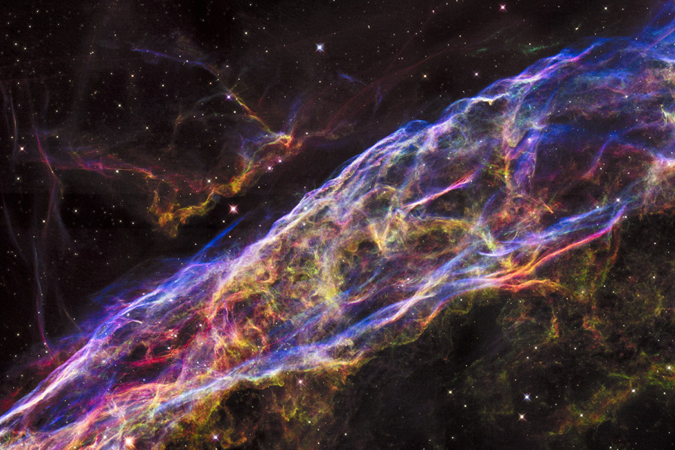 A new mosaic image captured by the NASA/ESA Hubble Space Telescope and released on 9/24/15 shows an incredibly detailed look at a small section of the remains of a massive star that exploded about 8,000 years ago.  Called the Veil Nebula, it is one of the best-known supernova remnants. The entire nebula is 110 light-years across and sits about 2,100 light-years away in the constellation Cygnus, the Swan. (NASA, ESA, and the Hubble Heritage Team (STScI/AURA))