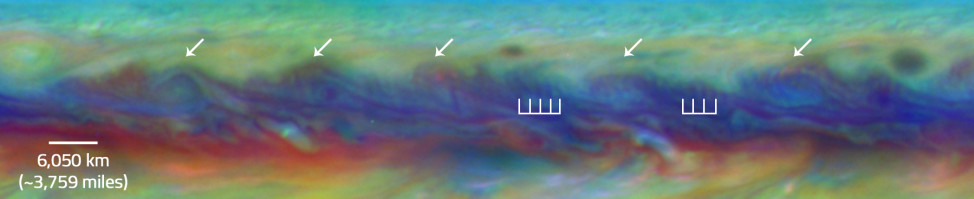 In Jupiter's North Equatorial Belt, scientists spotted a rare wave that had been seen there only once before. It is similar to a wave that sometimes occurs in Earth's atmosphere when cyclones are forming. This false-color close-up of Jupiter shows cyclones (arrows) and the wave (vertical lines). (NASA/ESA/Goddard/UCBerkeley/JPL-Caltech/STScI)