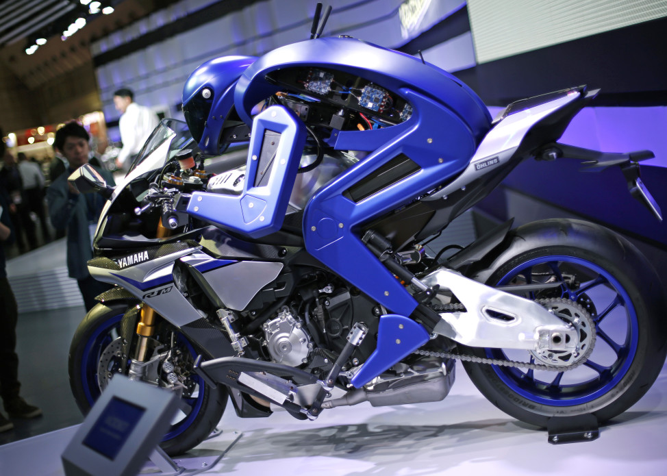 Yamaha's autonomous motorcycle-riding humanoid concept model is displayed during the 10/29/15 media preview of the Tokyo Motor Show in Tokyo. The Japanese vehicle exhibition opened to the public on 10/30/15 (AP)