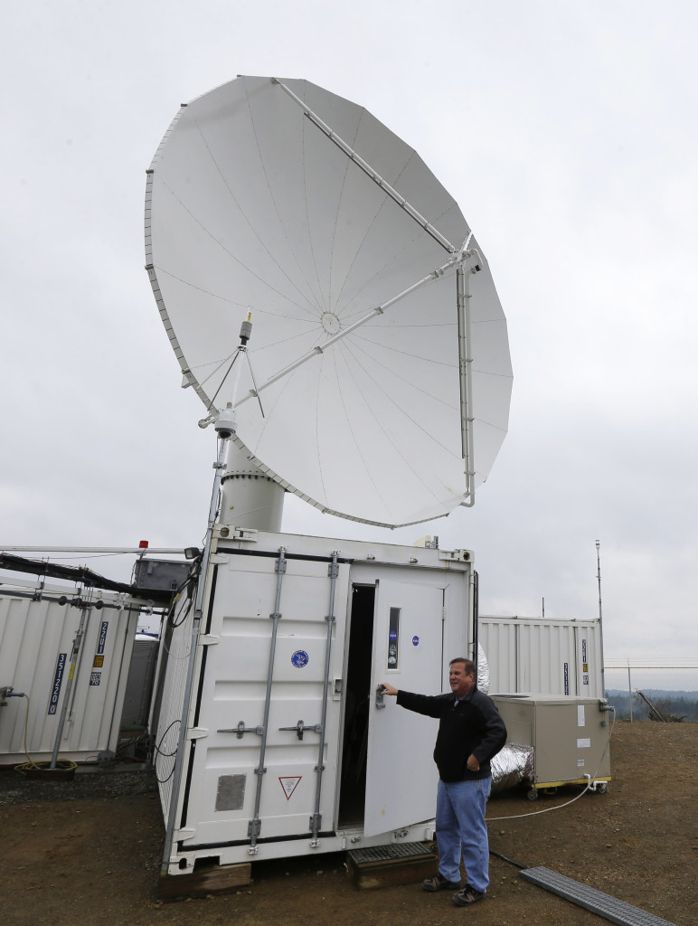 David Wolff, a research scientist with NASA, opens the door to a mobile workspace on a hilltop near Moclips, Washington on 11/6/15. Wolff and other scientists measured raindrops and snowdrops in one of the wettest spots in the US.  Scientists are attempting to validate, on the ground, how well global satellites measure precipitation from space. (AP)