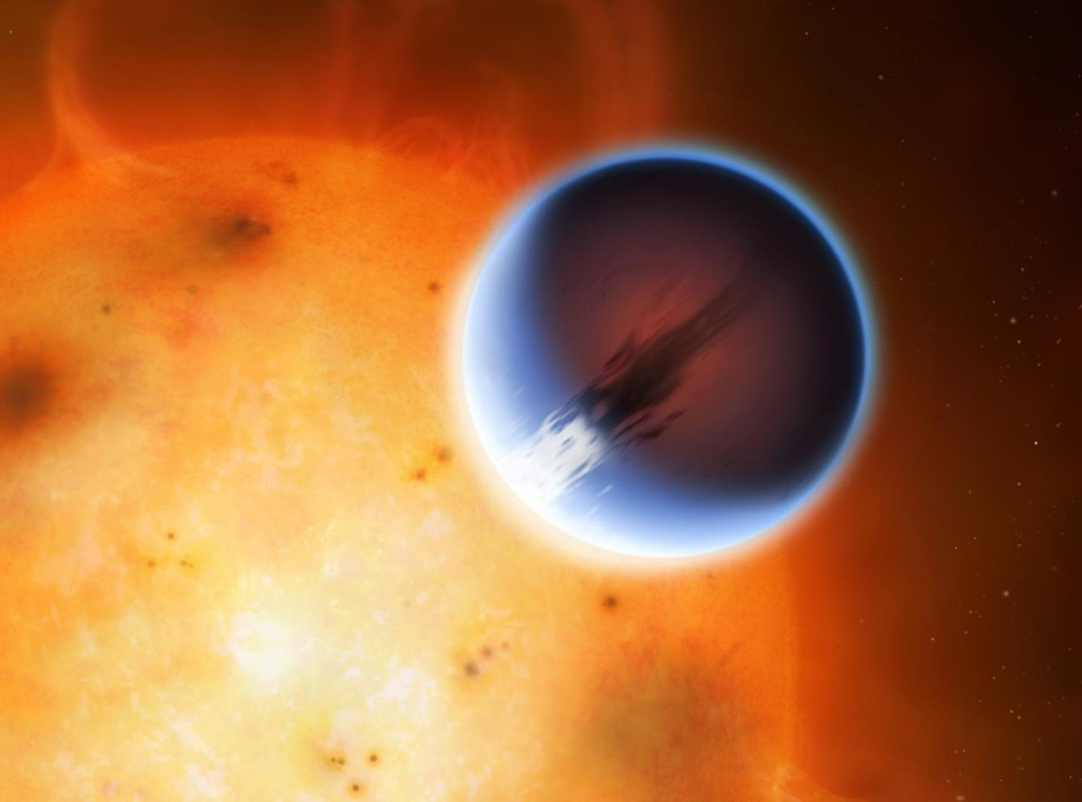 The planet HD 189733b is shown here in front of its parent star. A belt of wind around the equator of the planet travels at At nearly 8,700 kilometers per hour from its day side to the night side. The day side of the planet appears blue due to scattering of light from silicate haze in the atmosphere. The night side of the planet glows a deep red due to its high temperature. (Mark A. Garlick/University of Warwick)